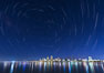 Star Trails over the San Diego Downtown City Skyline.  In this 60 minute exposure, stars create trails through the night sky over downtown San Diego. California, USA. Image #28385