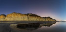 Torrey Pines Cliffs lit at night by a full moon, low tide reflections. Torrey Pines State Reserve, San Diego, California, USA. Image #28456