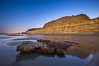 Torrey Pines Cliffs lit at night by a full moon, low tide reflections. Torrey Pines State Reserve, San Diego, California, USA. Image #28461