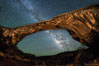 Owachomo Bridge and Milky Way.  Owachomo Bridge, a natural stone bridge standing 106' high and spanning 130' wide,stretches across a canyon with the Milky Way crossing the night sky. Natural Bridges National Monument, Utah, USA. Image #28545