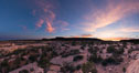 Panorama of Natural Bridges National Monument at sunset. Owachomo Bridge is visible at far left, while Natural Bridges National Monument lies under a beautiful sunset. Natural Bridges National Monument, Utah, USA. Image #28551