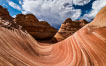 The Wave in the North Coyote Buttes, an area of fantastic eroded sandstone featuring beautiful swirls, wild colors, countless striations, and bizarre shapes set amidst the dramatic surrounding North Coyote Buttes of Arizona and Utah. The sandstone formations of the North Coyote Buttes, including the Wave, date from the Jurassic period. Managed by the Bureau of Land Management, the Wave is located in the Paria Canyon-Vermilion Cliffs Wilderness and is accessible on foot by permit only. North Coyote Buttes, Paria Canyon-Vermilion Cliffs Wilderness, Arizona, USA. Image #28601