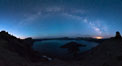 Milky Way and stars over Crater Lake at night. Panorama of Crater Lake and Wizard Island at night, Crater Lake National Park. Oregon, USA. Image #28635