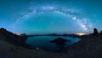 Milky Way and stars over Crater Lake at night. Panorama of Crater Lake and Wizard Island at night, Crater Lake National Park. Oregon, USA. Image #28641