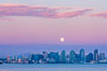 "Blue Moon at Sunset over San Diego City Skyline.  The third full moon in a season, this rare ""blue moon"" rises over San Diego just after sundown. California, USA. Image #28754"
