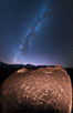 The Milky Way at Night over Sky Rock.  Sky Rock petroglyphs near Bishop, California. Hidden atop an enormous boulder in the Volcanic Tablelands lies Sky Rock, a set of petroglyphs that face the sky. These superb examples of native American petroglyph artwork are thought to be Paiute in origin, but little is known about them. USA. Image #28804