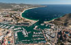 Cabo San Lucas, marina and downtown, showing extensive development and many resorts and sport fishing boats. Baja California, Mexico. Image #28884