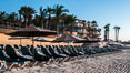 Beach chairs and umbrellas line the sand in front of resorts on Medano Beach, Cabo San Lucas, Mexico. Baja California. Image #28947