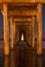 Full moon setting over the Pacific lights the inside of Scripps Pier. La Jolla, California, USA. Image #28983