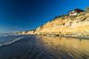 Black's Beach sea cliffs, sunset, looking north from Scripps Pier with Torrey Pines State Reserve in the distance. La Jolla, California, USA. Image #29166
