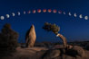 Lunar Eclipse and blood red moon sequence, over Juniper and Standing Rock, composite image, Joshua Tree National Park, April 14/15 2014. Image #29204