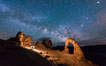 Light Painting and the Milky Way and Stars over Delicate Arch, at night, Arches National Park, Utah. Delicate Arch, Arches National Park, Utah, USA. Image #29288