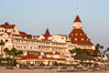Hotel del Coronado, known affectionately as the Hotel Del. It was once the largest hotel in the world, and is one of the few remaining wooden Victorian beach resorts. It sits on the beach on Coronado Island, seen here with downtown San Diego in the distance. It is widely considered to be one of Americas most beautiful and classic hotels. Built in 1888, it was designated a National Historic Landmark in 1977. California, USA. Image #29419