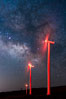 Ocotillo Wind Energy Turbines, at night with stars and the Milky Way in the sky above, the moving turbine blades illuminated by a small flashlight. Ocotillo, California, USA. Image #30236