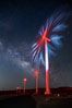 Ocotillo Wind Energy Turbines, at night with stars and the Milky Way in the sky above, the moving turbine blades illuminated by a small flashlight. Ocotillo, California, USA. Image #30239