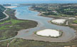 Aerial photo of Batiquitos Lagoon, Carlsbad. The Batiquitos Lagoon is a coastal wetland in southern Carlsbad, California. Part of the lagoon is designated as the Batiquitos Lagoon State Marine Conservation Area, run by the California Department of Fish and Game as a nature reserve. Carlsbad, Callifornia, USA. Image #30563