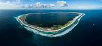 Aerial panorama of Clipperton Island, showing the entire atoll.  Clipperton Island, a minor territory of France also known as Ile de la Passion, is a small (2.3 sq mi) but  spectacular coral atoll in the eastern Pacific. By permit HC / 1485 / CAB (France). Clipperton Island, France. Image #32843