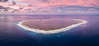 Sunset at Clipperton Island, aerial panoramic photo showing the entire atoll.  Clipperton Island, a minor territory of France also known as Ile de la Passion, is a small (2.3 sq mi) but  spectacular coral atoll in the eastern Pacific. By permit HC / 1485 / CAB (France). Image #32895