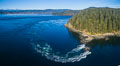 Seymour Narrows with strong tidal currents.  Between Vancouver Island and Quadra Island, Seymour Narrows is about 750 meters wide and has currents reaching 15 knots.  Aerial photo. British Columbia, Canada. Image #34490