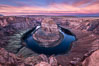 Spectacular Horseshoe Bend sunrise. The Colorado River makes a 180-degree turn at Horseshoe Bend. Here the river has eroded the Navajo sandstone for eons, digging a canyon 1100-feet deep. Page, Arizona, USA. Image #35941