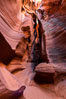 Canyon X, a spectacular slot canyon near Page, Arizona.  Slot canyons are formed when water and wind erode a cut through a (usually sandstone) mesa, producing a very narrow passage that may be as slim as a few feet and a hundred feet or more in height. Page, Arizona, USA. Image #36008