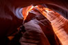 Canyon X, a spectacular slot canyon near Page, Arizona.  Slot canyons are formed when water and wind erode a cut through a (usually sandstone) mesa, producing a very narrow passage that may be as slim as a few feet and a hundred feet or more in height. Page, Arizona, USA. Image #36013