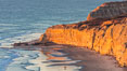 Torrey Pines sea cliffs at sunset, Flat Rock at low tide, looking north. Blacks Beach, La Jolla, California, USA. Image #36557