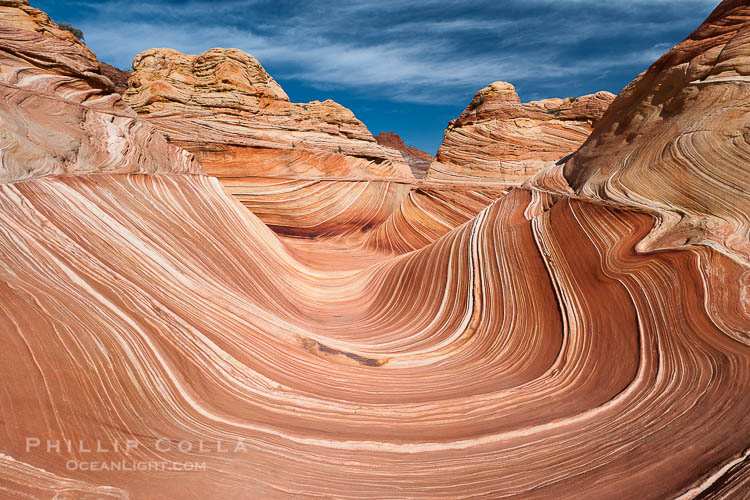The Wave, an area of fantastic eroded sandstone featuring beautiful swirls, wild colors, countless striations, and bizarre shapes set amidst the dramatic surrounding North Coyote Buttes of Arizona and Utah.  The sandstone formations of the North Coyote Buttes, including the Wave, date from the Jurassic period. Managed by the Bureau of Land Management, the Wave is located in the Paria Canyon-Vermilion Cliffs Wilderness and is accessible on foot by permit only.