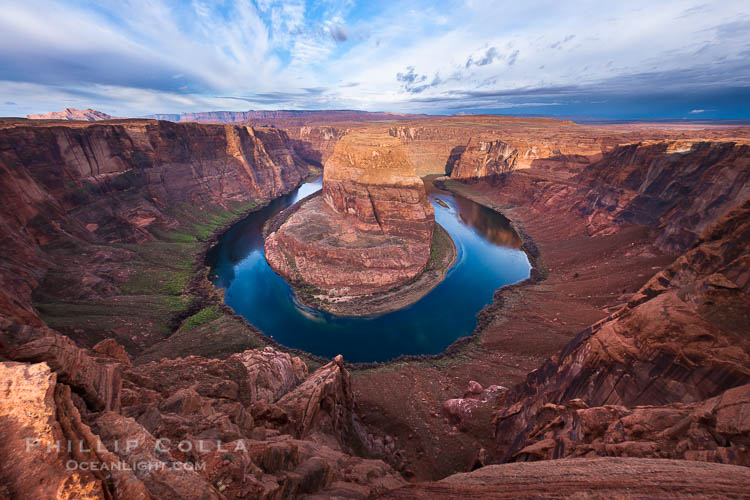 Horseshoe Bend. The Colorado River makes a 180-degree turn at Horseshoe Bend. Here the river has eroded the Navajo sandstone for eons, digging a canyon 1100-feet deep.