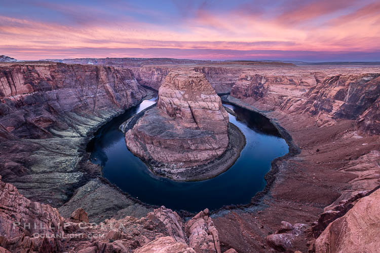 Spectacular Horseshoe Bend sunrise. The Colorado River makes a 180-degree turn at Horseshoe Bend. Here the river has eroded the Navajo sandstone for eons, digging a canyon 1100-feet deep