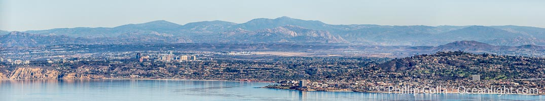 Aerial Panorama of La Jolla, University City, showing (from left) UCSD, University City, Scripps Institution of Oceanography, La Jolla Shores, Point La Jolla, Mount Soledad, in the background some of the mountains to the east of San Diego.  The highest peak in the center of the panoram is Cuyamaca Peak (6512') while the rocky peak directly in front of it is El Cajon Mountain (3675')., natural history stock photograph, photo id 29098