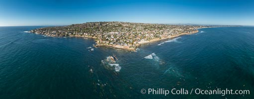 Aerial Panoramic Photo of Bird Rock and La Jolla Coast, with surfers in the waves.  Pacific Beach and Mission Beach are to the far right (south).  La Jolla's Mount Soledad rises in the center.  The submarine reefs around Bird Rock are visible through the clear water. This extremely high resolution panorama will print 80 inches high by 200 inches wide. California, USA, natural history stock photograph, photo id 30778