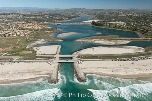 Aerial photo of Batiquitos Lagoon, Carlsbad. The Batiquitos Lagoon is a coastal wetland in southern Carlsbad, California. Part of the lagoon is designated as the Batiquitos Lagoon State Marine Conservation Area, run by the California Department of Fish and Game as a nature reserve. Callifornia, USA, natural history stock photograph, photo id 30555