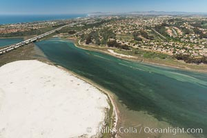 Aerial photo of Batiquitos Lagoon, Carlsbad. The Batiquitos Lagoon is a coastal wetland in southern Carlsbad, California. Part of the lagoon is designated as the Batiquitos Lagoon State Marine Conservation Area, run by the California Department of Fish and Game as a nature reserve. Callifornia, USA, natural history stock photograph, photo id 30560