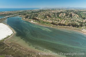 Image 30561, Aerial photo of Batiquitos Lagoon, Carlsbad. The Batiquitos Lagoon is a coastal wetland in southern Carlsbad, California. Part of the lagoon is designated as the Batiquitos Lagoon State Marine Conservation Area, run by the California Department of Fish and Game as a nature reserve. Carlsbad, Callifornia, USA, Phillip Colla, all rights reserved worldwide. Keywords: above, aerial, aerial photo, aerial photograph, aloft, batiquitos, batiquitos lagoon, batiquitos lagoon state marine conservation area, california, carlsbad, coast, lagoon, lighthawk, marine, marine protected area, marsh, mpa, nature reserve, ocean, outdoors, outside, san diego, scene, scenery, scenic, usa, wetland.