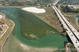 Aerial photo of Batiquitos Lagoon, Carlsbad. The Batiquitos Lagoon is a coastal wetland in southern Carlsbad, California. Part of the lagoon is designated as the Batiquitos Lagoon State Marine Conservation Area, run by the California Department of Fish and Game as a nature reserve. Carlsbad, Callifornia, USA, natural history stock photograph, photo id 30566