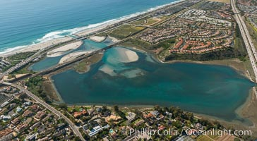 Aerial photo of Batiquitos Lagoon, Carlsbad. The Batiquitos Lagoon is a coastal wetland in southern Carlsbad, California. Part of the lagoon is designated as the Batiquitos Lagoon State Marine Conservation Area, run by the California Department of Fish and Game as a nature reserve. Callifornia, USA, natural history stock photograph, photo id 30665