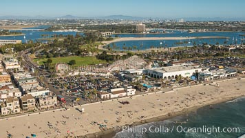 Aerial photo of Belmont Park, the Giant Dipper roller coaster, Mission Bay and San Diego in the distance