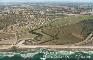 Aerial photo of Los Penasquitos Lagoon. Los Pe�asquitos Marsh Natural Preserve and Lagoon is a coastal marsh in San Diego County, California, USA situated at the northern edge of the City of San Diego, forming the natural border with Del Mar, California
