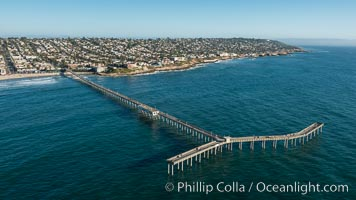 Aerial Photo of Ocean Beach Pier. Ocean Beach Pier, also known as the OB Pier or Ocean Beach Municipal Pier, is the longest concrete pier on the West Coast measuring 1971 feet (601 m) long. Sunset Cliffs and Point Loma extend off to the south, natural history stock photograph, photo id 30753
