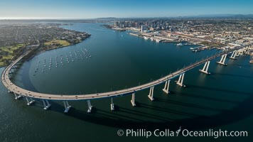 Aerial Photo of San Diego Coronado Bridge, known locally as the Coronado Bridge, links San Diego with Coronado, California. The bridge was completed in 1969 and was a toll bridge until 2002. It is 2.1 miles long and reaches a height of 200 feet above San Diego Bay. Coronado Island is to the left, and downtown San Diego is to the right in this view looking north