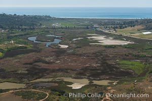 Aerial Photo of San Elijo Lagoon. San Elijo Lagoon Ecological Reserve is one of the largest remaining coastal wetlands in San Diego County, California, on the border of Encinitas, Solana Beach and Rancho Santa Fe. Encinitas, California, USA, natural history stock photograph, photo id 30590