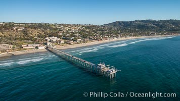 Aerial Photo of Scripps Pier. SIO Pier. The Scripps Institution of Oceanography research pier is 1090 feet long and was built of reinforced concrete in 1988, replacing the original wooden pier built in 1915. The Scripps Pier is home to a variety of sensing equipment above and below water that collects various oceanographic data. The Scripps research diving facility is located at the foot of the pier. Fresh seawater is pumped from the pier to the many tanks and facilities of SIO, including the Birch Aquarium. The Scripps Pier is named in honor of Ellen Browning Scripps, the most significant donor and benefactor of the Institution, natural history stock photograph, photo id 30737