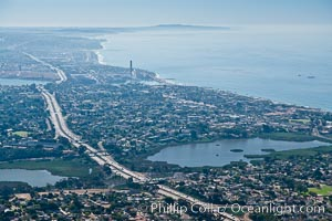 Aerial view of coastal Carlsbad and Oceanside, looking south.  The I-5 freeway and Buena Vista Lagoon are seen in the center of the photo