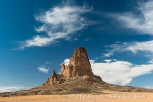 Agaltha Peak, also know as El Capitan Peak, rises to over 1500' in height near Kayenta, Arizona and Monument Valley.  Agathla Peak is an eroded volcanic plug consisting of volcanic breccia cut by dikes of an unusual igneous rock called minette