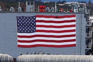 American flag, huge, hanging on the side of a Navy ship, San Diego, California