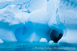 Antarctic icebergs, sculpted by ocean tides into fantastic shapes. Cierva Cove, Antarctic Peninsula, Antarctica, natural history stock photograph, photo id 25502