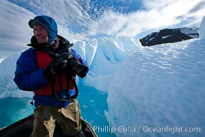Photographer Patrick Endres works alongside an iceberg near Paulet Island