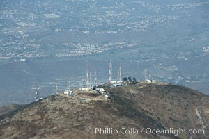 Antenna towers atop San Miguel Mountain, aerial view.  San Miguel Mountain reaches an altitude of 2565 feet, and hosts commercial radio and television antennas for the San Diego region, east of downtown San Diego