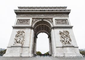 "Arc de Triomphe. The Arc de Triomphe (Arc de Triomphe de l'Etoile) is one of the most famous monuments in Paris. It stands in the centre of the Place Charles de Gaulle (originally named Place de l'Etoile), at the western end of the Champs-Elysees. The Arc de Triomphe (in English: ""Triumphal Arch"") honors those who fought and died for France in the French Revolutionary and the Napoleonic Wars, with the names of all French victories and generals inscribed on its inner and outer surfaces. Beneath its vault lies the Tomb of the Unknown Soldier from World War I. The monument was designed by Jean Chalgrin in 1806, and its iconographic program pitted heroically nude French youths against bearded Germanic warriors in chain mail. It set the tone for public monuments, with triumphant patriotic messages. The monument stands 50 metres (164 ft) in height, 45 m (148 ft) wide and 22 m (72 ft) deep. Arc de Triomphe, Paris, France, natural history stock photograph, photo id 28084"